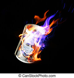 COVID-19 coronavirus in USA. Roll of hundred dollars money bill with face mask and in fire.