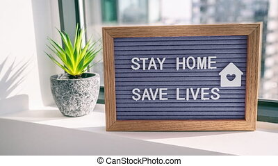 COVID-19 Coronavirus STAY HOME SAVE LIVES viral social media message sign with text for social distancing awareness. COVID-19 staying at home concept. Flatten the curve.