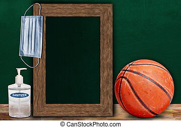COVID-19 New Normal Basketball Sports Concept With Frame Chalkboard and Copy Space