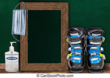 COVID-19 New Normal Skiing Sport Concept With Frame Chalkboard and Copy Space