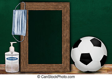 COVID-19 New Normal Soccer Sports Concept With Frame Chalkboard and Copy Space