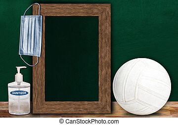 COVID-19 New Normal Volleyball Sports Concept With Frame Chalkboard and Copy Space