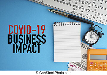 COVID19 BUSINESS IMPACT text with alarm clock, fountain pen, banknotes currencies, notepad and calculator on blue background
