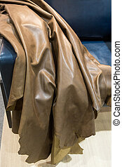 Cow hide leather tan background in the store.