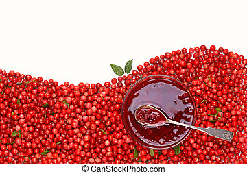 Cowberry jam on background of fresh ripe berries.