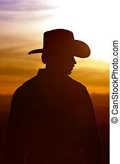 cowboy, árnykép, és, naplemente ég
