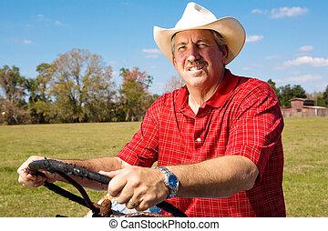 Cowboy at the Wheel