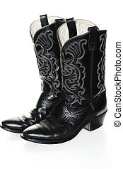 Cowboy Boots - Black western boots isolated over white,side...