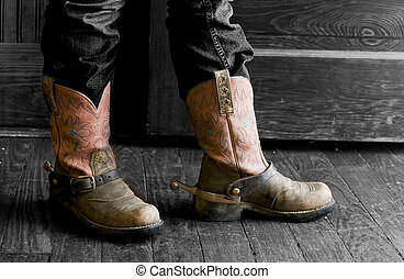 cowboy boots - A person standing in front of an open door,...