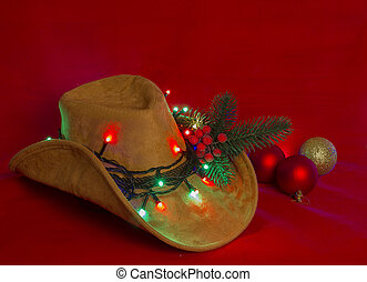 Cowboy Christmas. American West hat on christmas red background for text