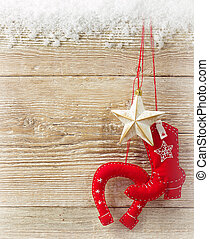 Cowboy christmas background with western toy boot and star on wood
