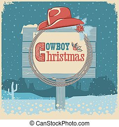 Cowboy christmas card with western hat and text on wood board