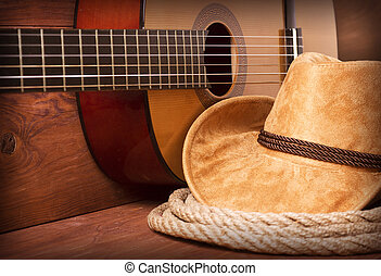 Cowboy country music image with guitar and american hat