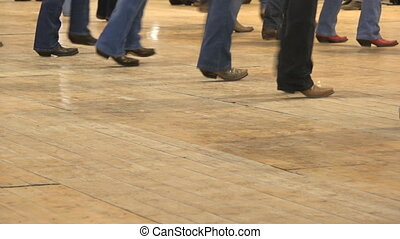 Cowboy dancing country line dance at a folk event, USA style