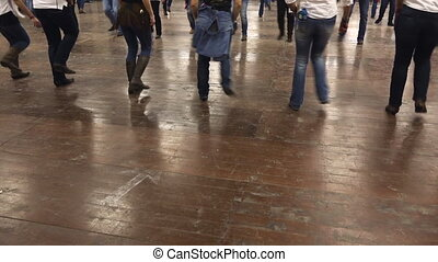 Cowboy dancing line dance, people have fun at country...