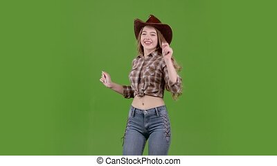 Cowboy girl dances energetic dances and sings. Green screen...