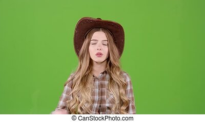 Cowboy girl is bored and depressed. Green screen - Cowboy...