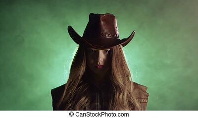Cowboy girl raises her head and looks into the distance....