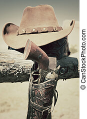 cowboy gun and hat outdoor in a ranch