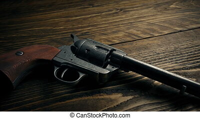 Cowboy Gun Picked By Gloved Hand - Wild west hand gun being...