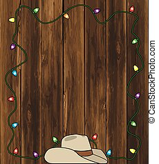Cowboy Hat and Christmas Lights - A cowboy hat is resting on...