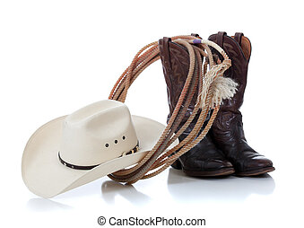Cowboy hat, boots and lariat on white - A white cowboy hat, ...