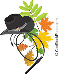 Cowboy hat on the autumn background - Cowboy hat and whip on...