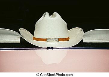 Cowboy hat on window, vintage