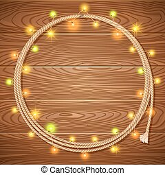 Cowboy lasso decorated christmas light garlands on wood background