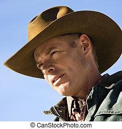 Cowboy. - Mid-adult Caucasian man wearing a cowboy hat.