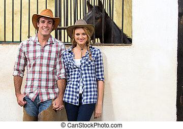 cowboy, och, cowgirl, par hand i lik hand