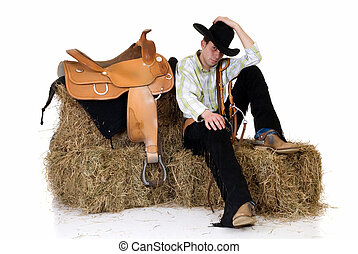 Cowboy on hay - Handsome young cowboy with traditional...
