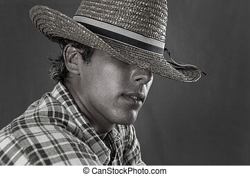 Cowboy - Portrait of young rude man wearing cowboy hat