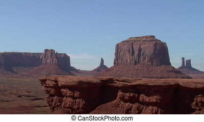 cowboy rides horse onto Cliff in Monument Valley Utah