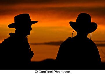 cowboy, silhouetten, an, sonnenuntergang