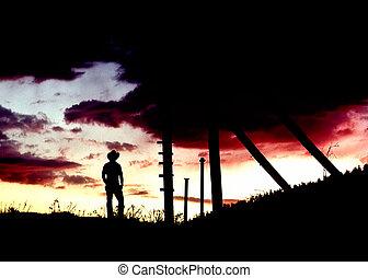 cowboy, stehende , bei, bergbau, kopf, rahmen, an, sonnenuntergang