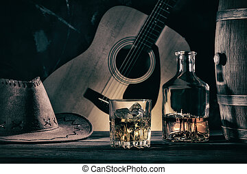 Cowboy Still Life Against Guitar