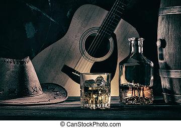 Cowboy Still Life Against Guitar