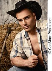 cowboy - Sexy cowboy on a haystack. Western style.