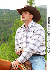 Cowboy - Passionate young cowboy spending time with his...