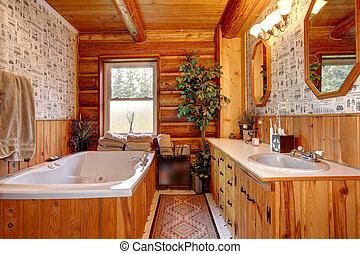 Cowboy wood cabin bathroom with tub.