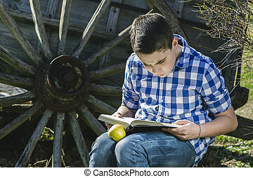 Cowboy young reading a book