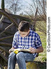 Cowboy young reading a book