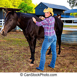 Cowgirl and horse - Close up of an attractive young female...