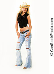 Cowgirl attire - Beautiful blond woman wearing straw cowboy...