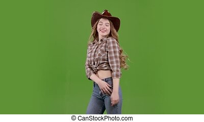 Cowgirl dancing the wind waving her hair around. Green screen. Slow motion