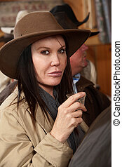 Cowgirl Holding a Shot in a Bar - A tough western woman ...