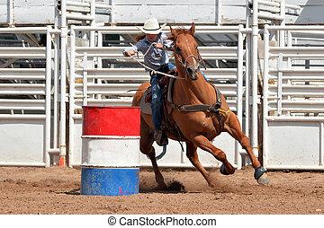 Cowgirl in a barrel race