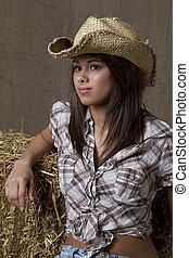 Cowgirl in barn