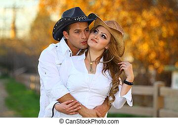 cowgirl, küssende , cowboy